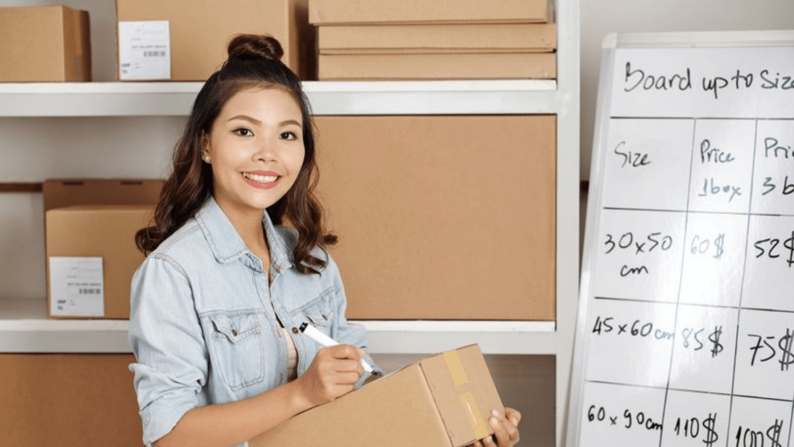 A woman holding a shipping box