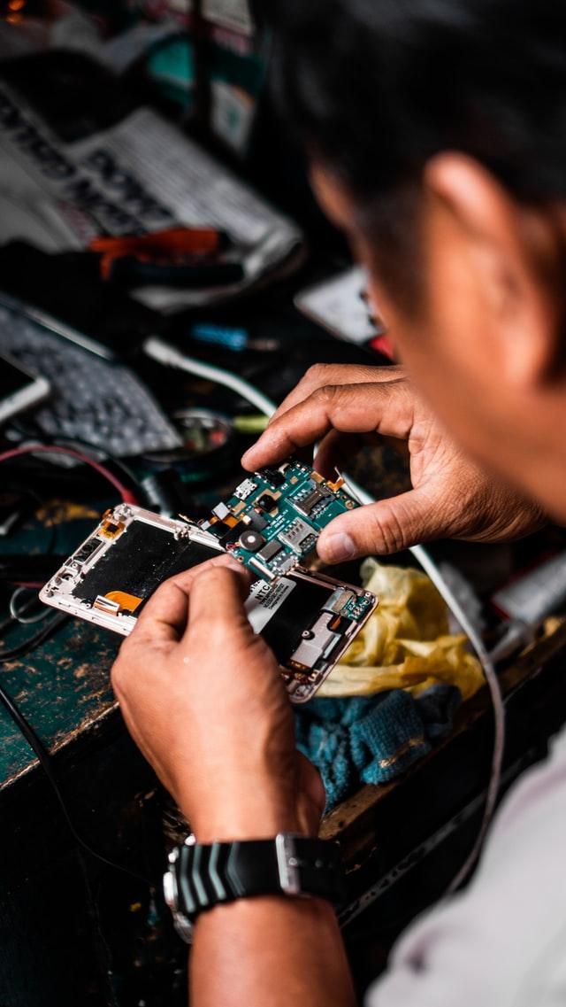 A man repairing a phone.